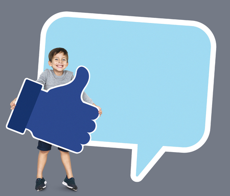 Boy with a speech bubble holding a thumbs up icon Stok Fotoğraf