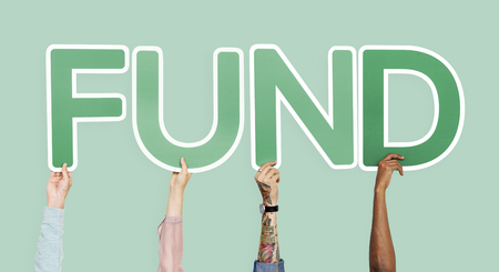 Hands holding up green letters forming the word fund