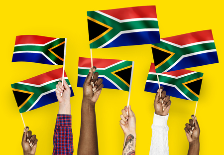 Hands waving flags of South Africa Standard-Bild - 111783053