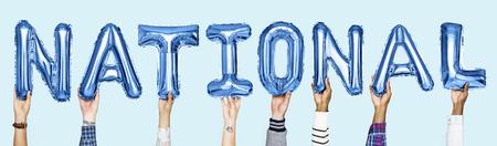 Blue alphabet balloons forming the word national Stok Fotoğraf