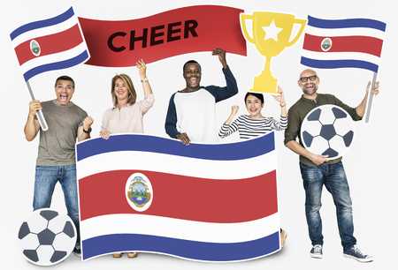 Diverse football fans holding the flag of Costa Rica