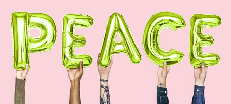 Green alphabet balloons forming the word peace Stock Photo