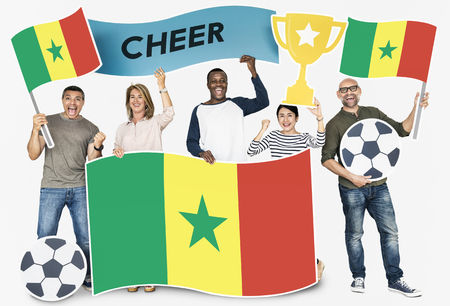 Diverse football fans holding the flag of Senegal Stock Photo