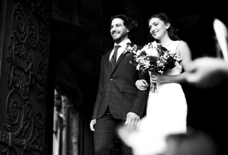 Newly wed couple walking out of the church