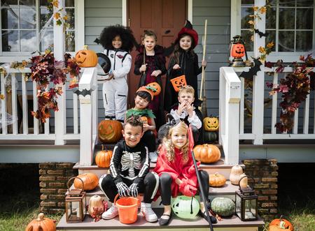 Little children in Halloween costumes Banco de Imagens