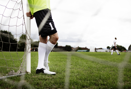 Male goalkeeper standing by the goal Stock Photo