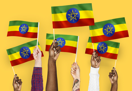 Hands waving flags of Ethiopia 스톡 콘텐츠 - 111784185