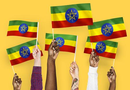 Hands waving flags of Ethiopia Stockfoto