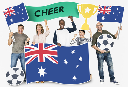 Diverse football fans holding the flag of Australia