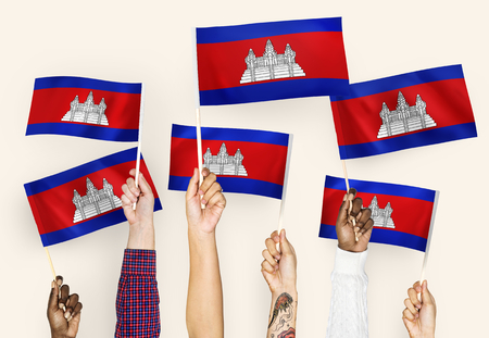Hands waving flags of Cambodia