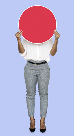 Woman holding up a blank board Stock Photo - 115739050