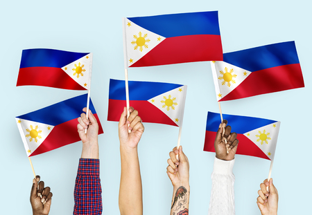 Hands waving flags of the Philippines Stok Fotoğraf