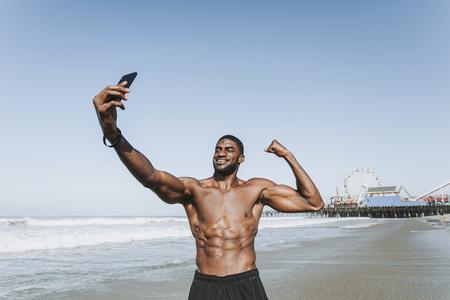 Fit man taking a selfie by Santa Monica Pier Stock Photo