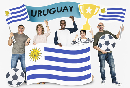 Diverse football fans holding the flag of Uruguay