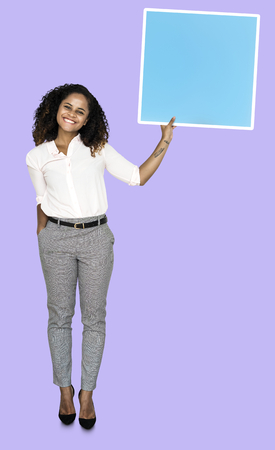 Woman holding up a blank board Stock Photo - 115739145