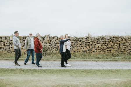 Group of elderly people strolling together