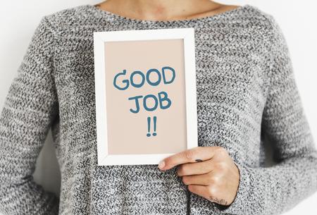 Woman holding a Good job frame