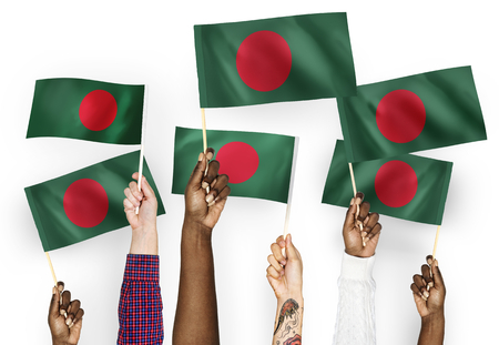 Hands waving flags of Bangladesh