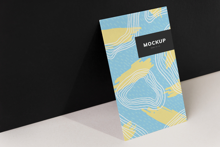Colorful paperboard mockup against the black wall