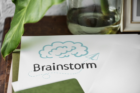 Word Brainstorm written on a paper Banco de Imagens