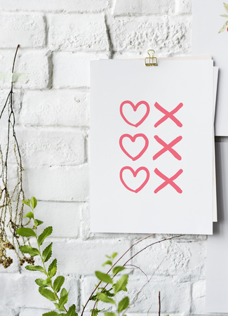 Hearts and kisses symbols poster on white wall