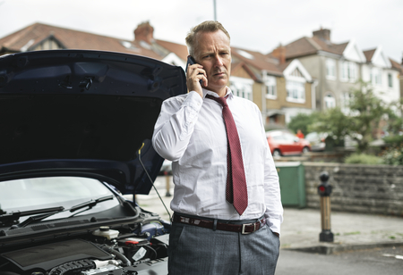 Businessman calling for help as his car broke down