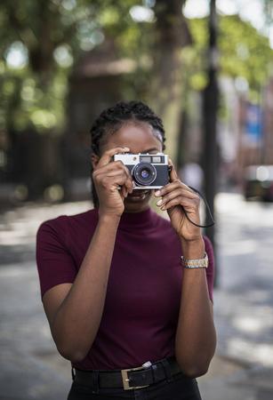 Beautiful model with an analog camera