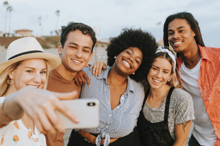 Group of diverse friends taking a selfie at the beach Stok Fotoğraf