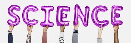 Hands holding science word in balloon letters Reklamní fotografie