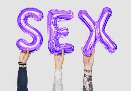 Hands holding sex word in balloon letters Stok Fotoğraf