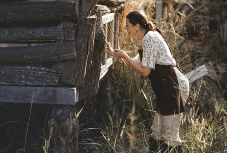 Farmer collecting eggs from the chicken coop