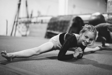 Young gymnast stretching her body Stock Photo