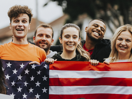 Group of young adults showing an American flag
