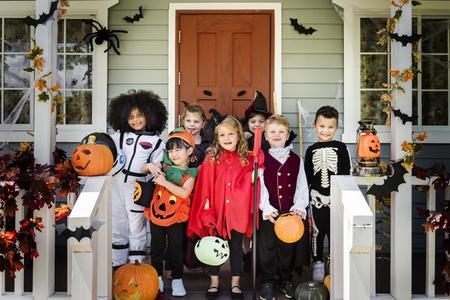 Little children in Halloween costumes 写真素材