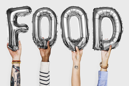 Hands showing food balloons word