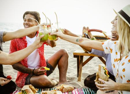 Diverse friends enjoying a beach picnic