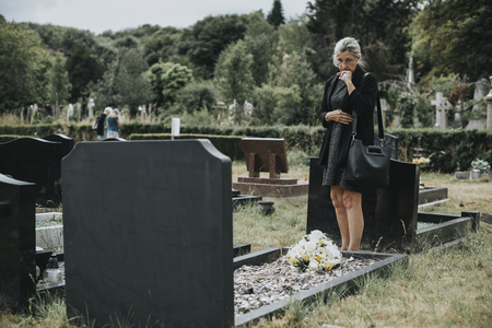 Old woman mourning her husband Stock Photo - 113301417