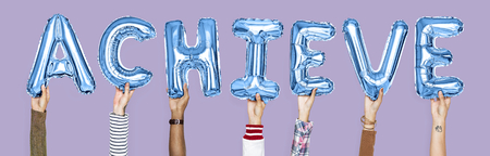Hands holding achieve word in balloon letters