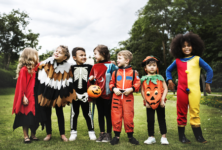 Little kids at a Halloween party Stockfoto