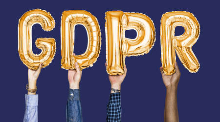 Hands holding GDPR word in balloon letters