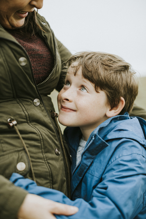 Happy son hugging his mother Stock Photo - 111926375