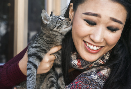 Happy woman spending time with her cat