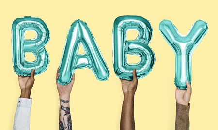 Hands showing baby balloons word 免版税图像