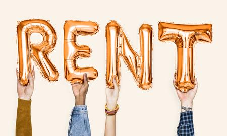 Orange alphabet balloons forming the word rent Standard-Bild - 112145959