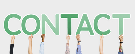 Hands holding up green letters forming the word contact