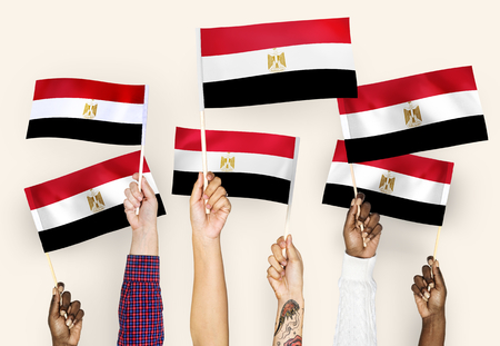 Hands waving the flags of Egypt