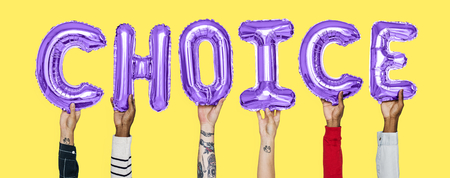 Hands holding choice word in balloon letters