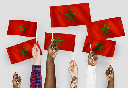 Hands waving the flags of Morocco