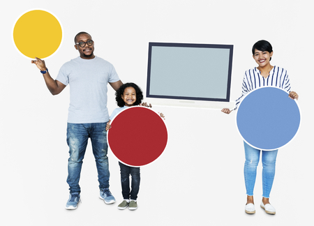 Happy family holding round boards and a screen