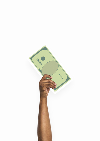 Hand holding a cash money cardboard prop